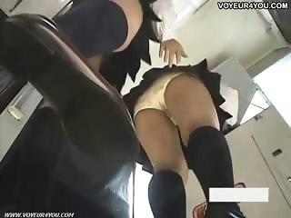 Schoolgirls panties wearing miniskirt