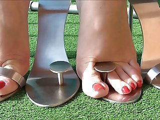 Sexy feet in metal heels 3