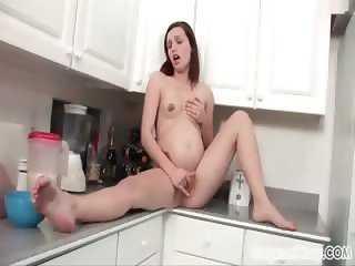 Prego babe plays with herself