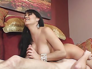 Curvy beauty with nice perky tits gives guy a hand job