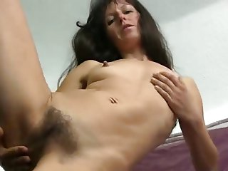 Hairy Mature Carmen toying her Pussy on the Chair