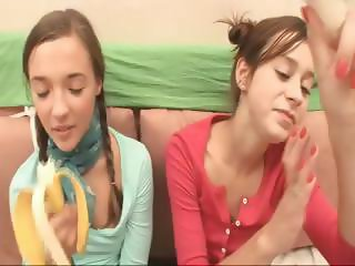 Two brunette teens are eating bananas and then show their tits