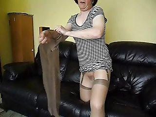 Glossy pantyhose nylons and dildo
