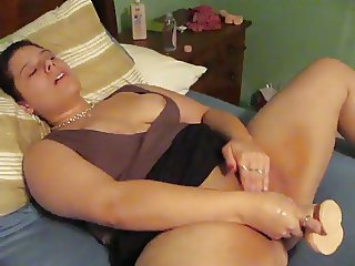 Chubby brunette with dildo