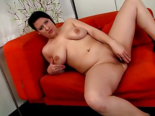 Fat girl strips and fucks toy