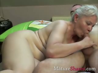 Blonde old woman does younger boy