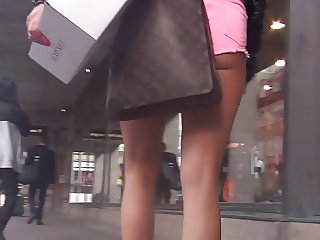 gorgeous and sexy blonde in minishorts with high heels