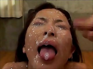 Japanese girl gets plenty of jizz
