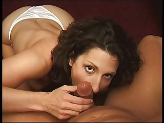 Skanky face brunette fondles and sucks a small dark cock