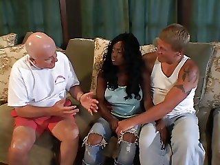 Ebony chick bangs 2 hard cocks
