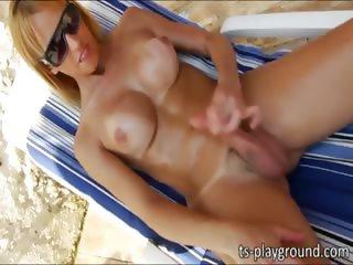 Sunbathing tgirl Gisele Ferrara jerk off
