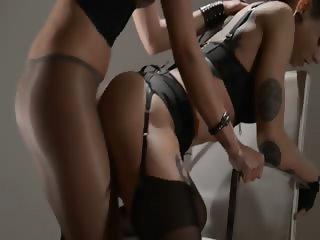 Tatto lezzs enjoying sex with strap on